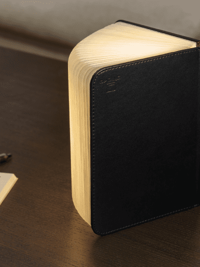 small black leather book light in a home