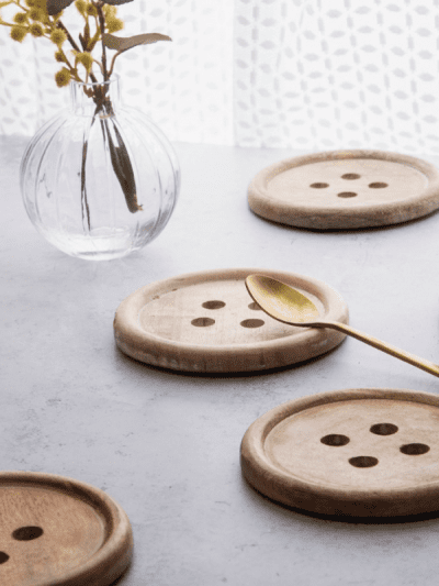 button coasters on a grey table, kitchen