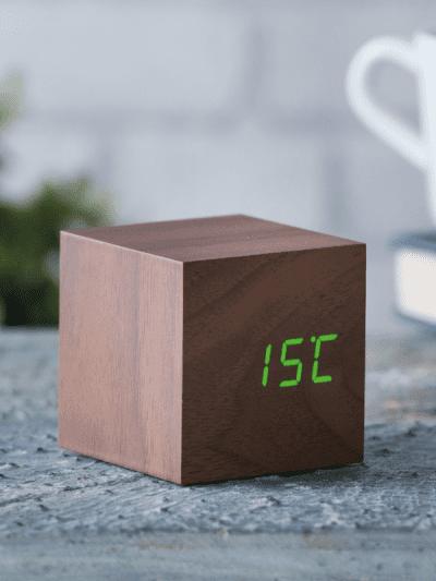 cube walnut clock in a home