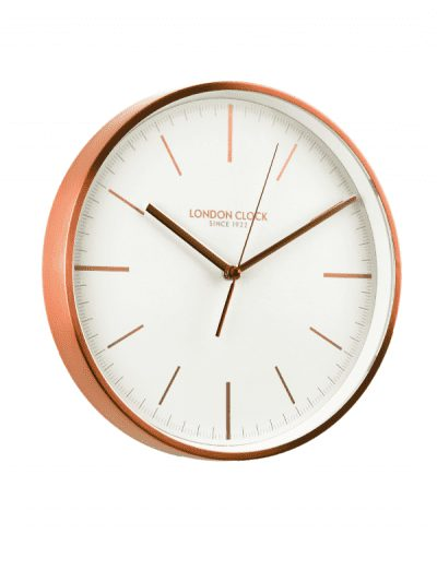 copper clock with white dial and copper hands