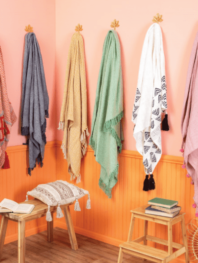 throws hanging up in a home on clothes hooks