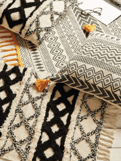 Scandi geometric prints on pillows and rug in a home