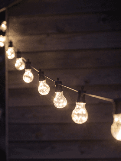 outdoor bulb lights on a rope in a garden