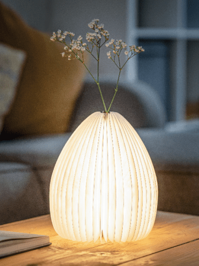 smart vase lamp on a coffee table