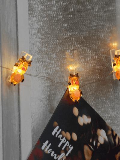 festive light up reindeer pegs